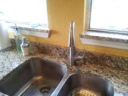 clogged kitchen sink garbage disposal drano unclog standing water