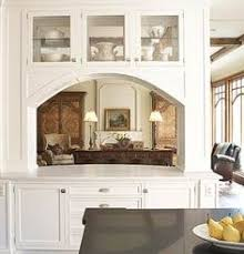 This Arched Opening To The Living Room Features A Marble Countertop That Functions As An Additional Island And Convenient Serving Station When