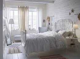 A White Small Bedroom Furnished With Romantic Metal Bed For Two Combined Side Tables