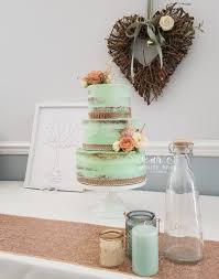 Mint And Peach Wedding Cake Three Tier Semi Naked With Flowers At