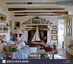 Nautical Living Room Sofas by Old Oars On Ceiling Beams In Nautical Themed Cottage Living Room