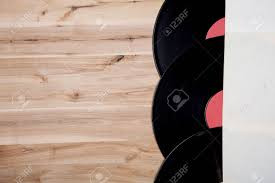 Top View Of Vinyl Records Over Wooden Table Stock Photo Picture And