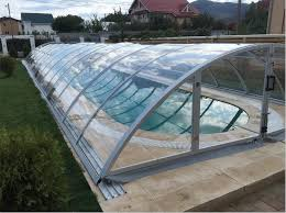 A Fully Installed Pool And Spa Enclosure That Covers The Entire Surface