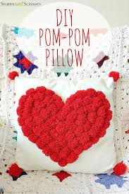 DIY Pom Pom Heart Pillow from Running with a Glue Gun Seams And