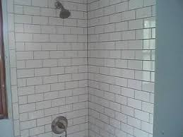 re grouting subway tile in bath