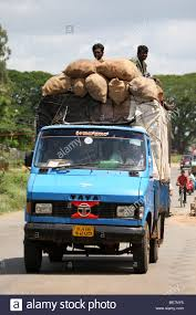 Men Sit On Top Of A Truck Carrying Sacks Of Rural Produce In India ... The Top 10 Most Expensive Pickup Trucks In The World Drive Want Best Resale Value Buy A Truck Car Pro Tonneau Covers For Ford F150 Customer Picks Truck Covered With Bumper Stickers Carries A Canoe On Top Culver 2 Easy Ways To Draw Pictures Wikihow House On Moving Road Stock Photo Picture And Chip Electronic Circuit Shown Back Of Big Light Bulb Four Things Consider When Choosing Lift Kit Foie Gras Pbj Served From Consuming La Video Pipeline Proster Climbs Gets Arrested 1931 Model At Royers Cafe Round Texas