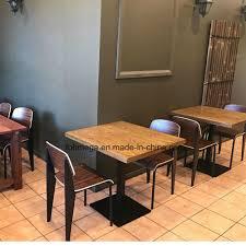 [Hot Item] Dark Color Wood Veneer Restaurant Dining Table With Black Powder  Coated Leg Table Chair Set