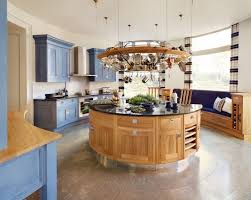 Semi Circle Wooden Kitchen Island With Majestic Utensiles Hanger Also Matte Blue Cabinet And Butcher Block Countertops Besides Window