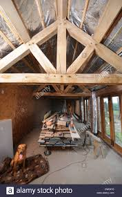 Restored Beams And Roofing Insulation Visible During A Barn Stock ... Pole Barn With Creatherm Floor Insulation Hydronic Heat Warm How To Build A Gambrel Roof Shed Howtospecialist Build We Love Horse Barn Zehr Building Llc Awesome Roof Framing Gambrel Truss With A Us Spray Foam Rentals Our Insulation Rental Equipment Best 25 Ideas On Pinterest Metal Olympus Digital Camera Garage Trusses Dramatic Gorgeous Work Completed By Mpi Using Open Cell Home Design 32x48 Buildings Menards Kits Under Cstruction Ksq Bncarriage Shed Update Hugh Lofting 27 Cversion Weeks 21 22 To Property Chetek Wi Smith 007 Youtube