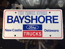 100 Bayshore Ford Truck Sales Delaware Plastic Dealer License Plate Vintage