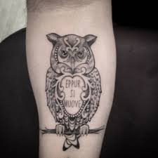 Forearm Tattoo Of An Owl With The Italian Quote Eppur Si Muove By