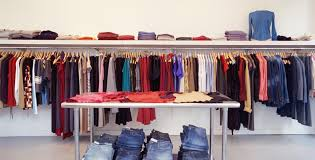 The When And Why To Use Wall Mounted Fixtures Mounts Pertaining Boutique Clothing Display Racks Designs