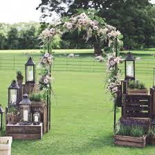 Made With Rustic Wooden Crates Lanterns And The Sweetest Floral Arch Plus You NEED To See Centrepieces