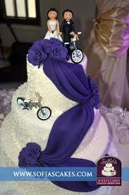 A 3 tier wedding cake creation with a custom cake topper by Sofia s