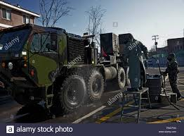 100 Patriot Truck A Republic Of Korea Army Soldier Sprays Down A US Army Heavy