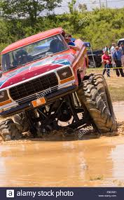 100 Truck Mudding Games A Monster Truck Outfitted With Special Tires Rides Through A Pool Of