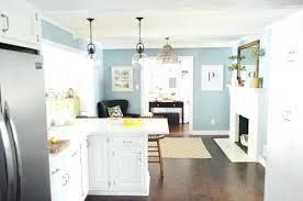 white kitchen light blue island kitchenaid mixer walls