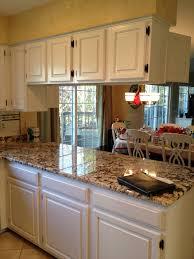 White Wooden Kitchen Cabinet And White Black Granite Countertopc