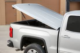 Top Your Pickup With A Tonneau Cover - GMC Life Truck Bed Covers Northwest Accsories Portland Or Rugged Hard Folding Tonneau Cover Autoaccsoriesgaragecom Used 02 09 Dodge Ram Hard Shell Fiberglass Tonneau Cover For Short 052015 Toyota Tacoma 61ft Standard Rollup Vinyl Amazoncom Tonno Pro 42506 Fold Black Trifold Heavy Duty Diamondback Hd Xmate Trifold Works With 2015 Advantage Surefit Snap Weathertech Roll Up Tyger Auto Tgbc3d1015 Trifold Whats The Difference In Cheap Vs More Expensive