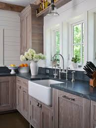 Chic Country Kitchen With Wire Brushed Oak Cabinets Paired Soapstone Countertops And White Wood Panel Backsplash