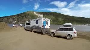RV Towing Car Loading Onto George Black Ferry To Cross Yukon River Toward Dawson City