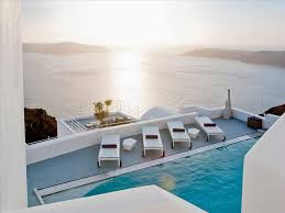 100 The Grace Santorini Hotel Infinity Pool Lounge Area Sunbathing