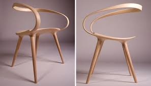 The Back Of This Sleek Dining Chair Is Made From A Single Piece Bent Wood Giving It Smooth Seamless Look