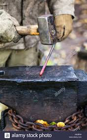 Blacksmith Forges Hot Steel Rod With Sledgehammer On Anvil In ... Henry Warkentins Blacksmith Shop Youtube How To Make A Simple Diy Blacksmiths Forge Picture With Excellent 100 Best Projects To Try Images On Pinterest Classes Backyard On Wonderful Plans For And Dog Danger Emporium L R Wicker Design 586 B C K S M I T H N G Fronnerie Backyards Ergonomic And Brake Drum An Artists Visiting The National Ornamental Metal 1200 Forging Ideas Forge Tongs In Country Outdoor Blacksmith Backyard Stock Photo This Is One Of The Railroad Spike Hatchets Made In My