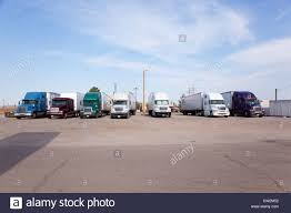 Trucks Parked Near Truck Stop One Driver Visible In Cab