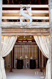 Sue Lou Events Barn Doors With Burlap Curtains Framing Cake Table On Barrels And