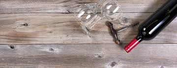 Download Unopen Bottle Of Red Wine And Clean Drinking Glasses On Rustic W Stock Image