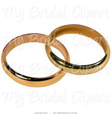 Two Gold Bridal Wedding Bands Resting To her