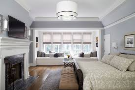 tufted sleigh bed in bedroom traditional with blue gray walls next