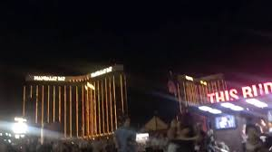People run outside the Mandalay Bay Hotel after a gunman opened