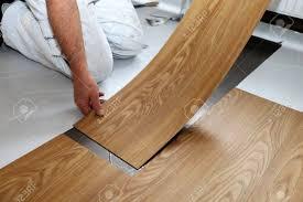 Man Laying Floor PVC Stock Photo
