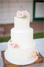 Simple White Wedding Cake With Flower Bouquet Topper T