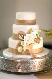 Rustic Wedding Cake With Burlap Trim Stands And Lace Table