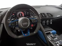 This Neidfaktor Audi R8 s a black and blue interior