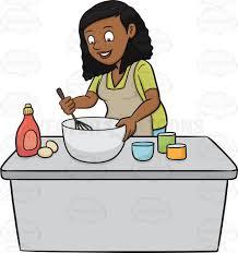 A black woman enjoys mixing the cake batter