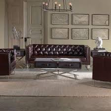 furniture transitional living room with white tufted leather sofa