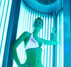 pros and cons of stand up tanning beds