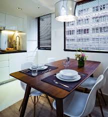 Dining Area And Kitchen The Walnut Table HK9200 Came From Ovo Studio 1Wan Chai Road Wan Tel 2527 6088 Herman Miller Eames Chairs