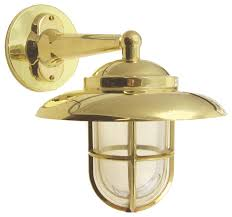 hooded wall light with cage solid brass interior exterior by