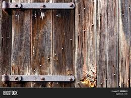 Old Barn Wood Door Iron Hinges Image & Photo | Bigstock Reclaimed Product List Old Barn Wood Google Search Textures Pinterest Barn Creating A Mason Jar Centerpiece From Old Wood Or Pallets Distressed Clapboard Background Stock Photo Picture Paneling Best House Design The Utestingcimedyeaoldbarnwoodplanks Amazoncom Cabinet This Simple Yet Striking Piece Christmas And New Year Backgroundfir Tree Branch On Free Images Vintage Grain Plank Floor Building Trunk For Sale Board Siding Lumber Bedroom Fniture Trellischicago Sign