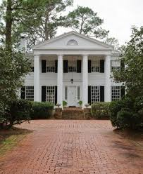 Southern Colonial Homes by An Alley Of Camellias Frames The Brick Drive Up To The Southern