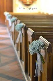 What A Wonderful Wedding Pew Bows Gypsophila End With Tulle Bow And Trails These Tied Designs Are Gorgeous For Church