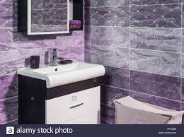 detail of fashionable bathroom in purple and gray color