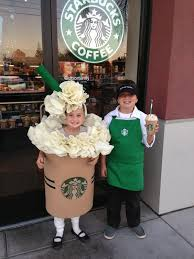 A Kids Duo In Starbucks Costumes