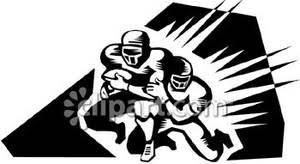 Football Player Tackling Another with the Ball Royalty Free