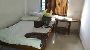 Hotel Lakshmi Paradise In A Small Room Approx 8x6 Having Bed